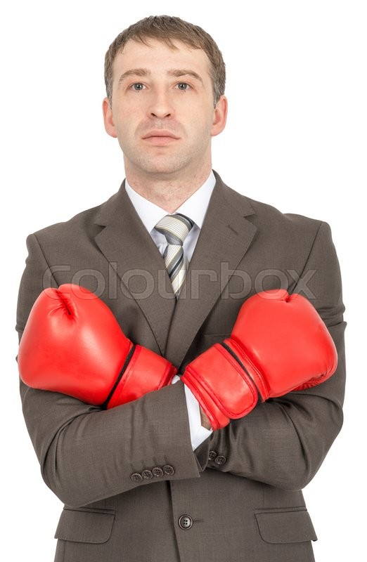 Stock image of 'Businessman with crossed arms in red boxing gloves  isolated on white background'