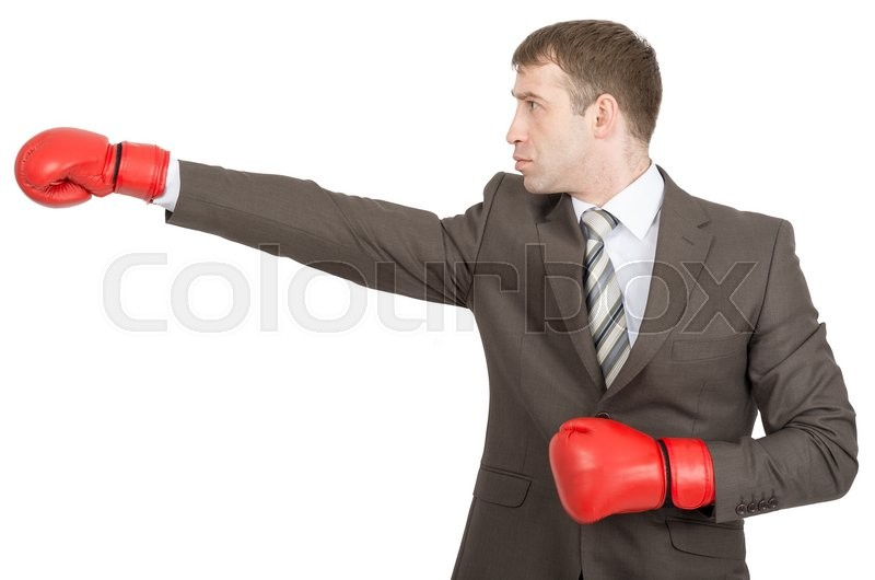 Stock image of 'Businessman in boxing gloves isolated on white background'
