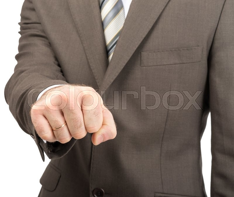 Stock image of 'Businessman showing fist isolated on white background'