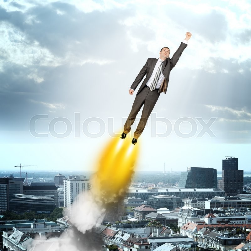 Stock image of 'Businessman in suit flying above city, front view'
