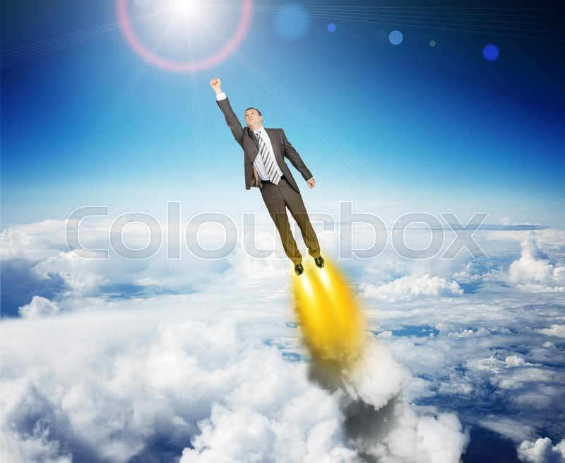 Stock image of 'Businessman in suit flying above sky with clouds'