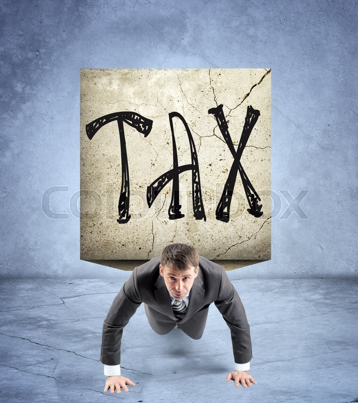 Stock image of 'Businessman doing push-ups with stone on back and word tax'