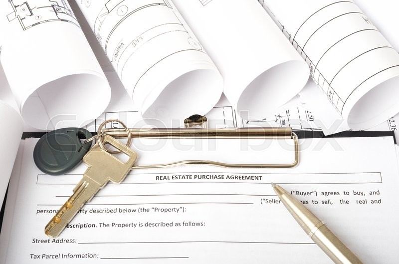 Stock image of 'Folder with key and pen on blueprint and blueprint rolls background, closeup'