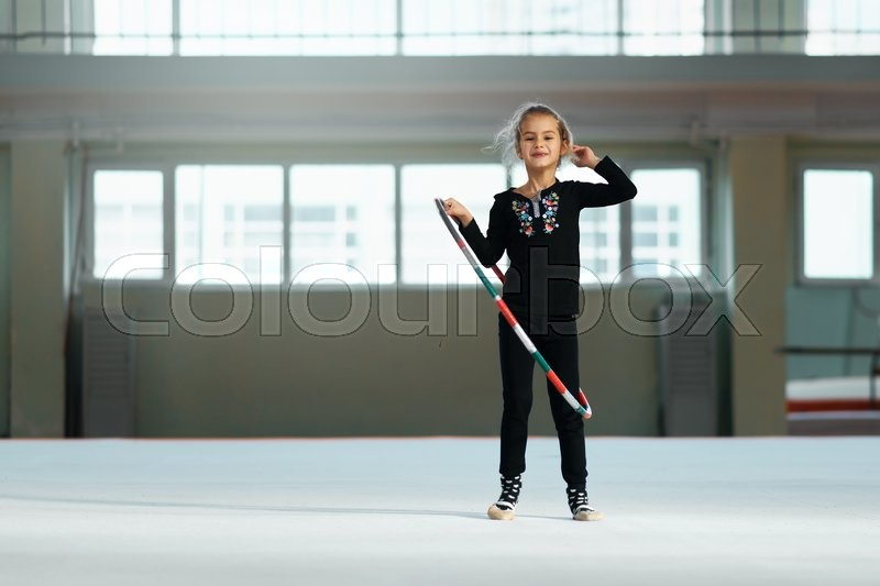 Stock image of 'beautiful girl with a hoop of rhythmic gymnastics.'