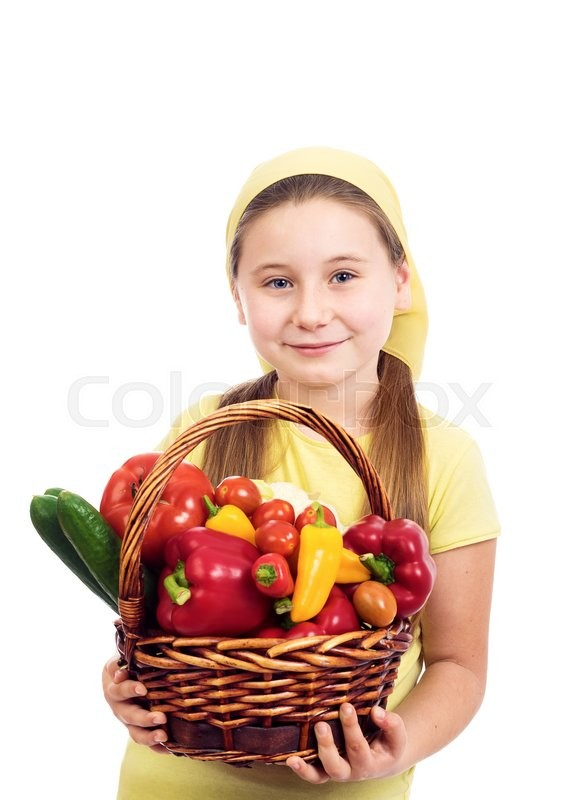 Stock image of 'the beautiful girl with a basket of vegetables was photographed on a white background in studio'