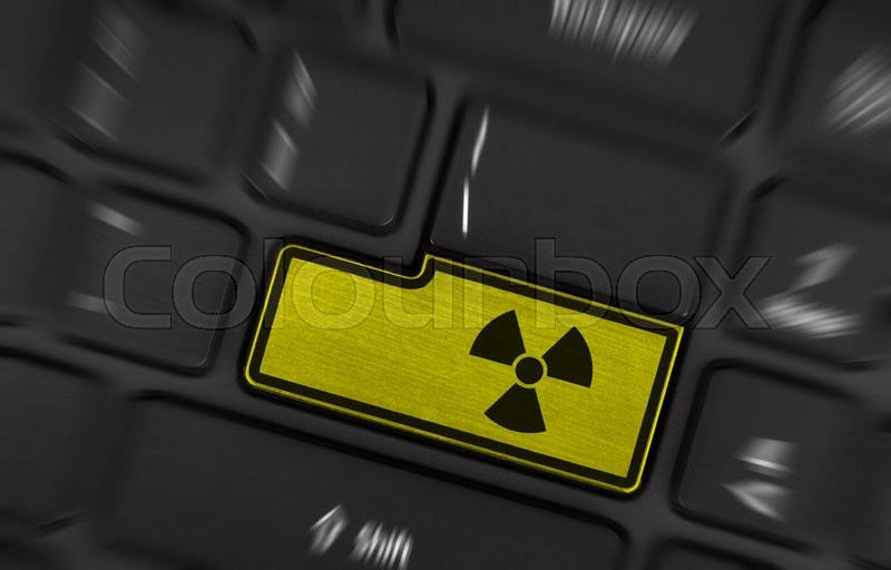 Stock image of 'Symbol on button keyboard, warning (yellow) - radioactive'
