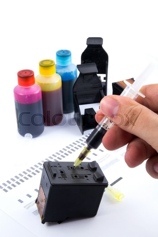 Stock image of 'Injecting ink cartridge. Set of refill inkjet for print.'