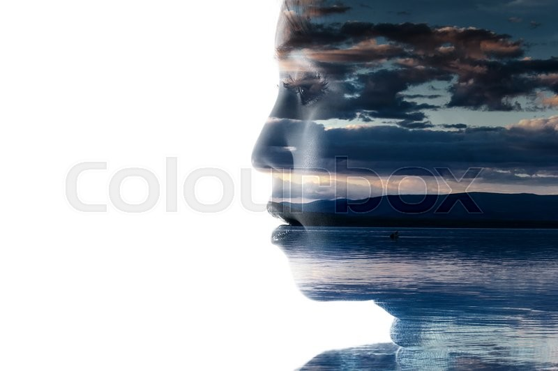 Stock image of 'Double exposure portrait of a woman combined with photograph of nature'