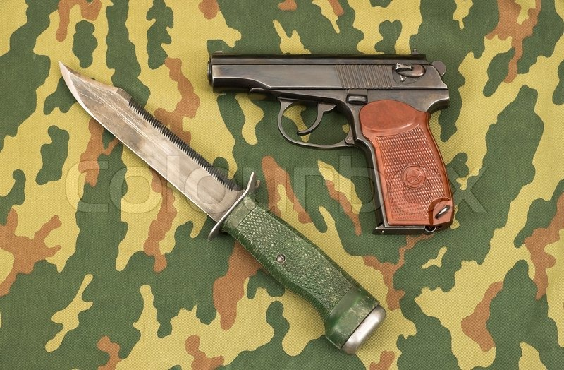Russian Army Knife And Handgun On Camouflage Background