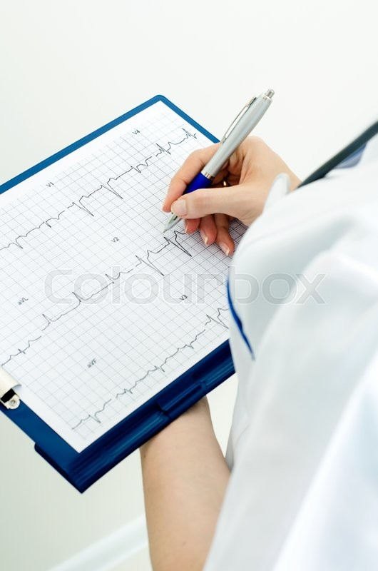 Stock image of 'Doctor with clipboard describes graph'