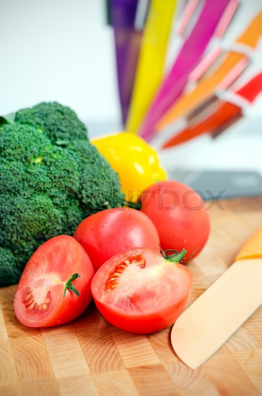 Stock image of 'Fresh vegetables on a chopping board in the kitchen'