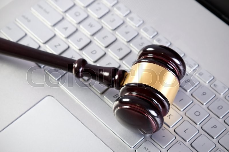 Stock image of 'Wooden judge hammer on laptop computer white keyboard'