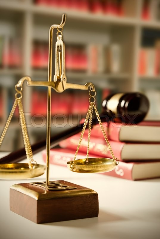 Stock image of 'Scale of Justice. Law composition with gavel on books in background'