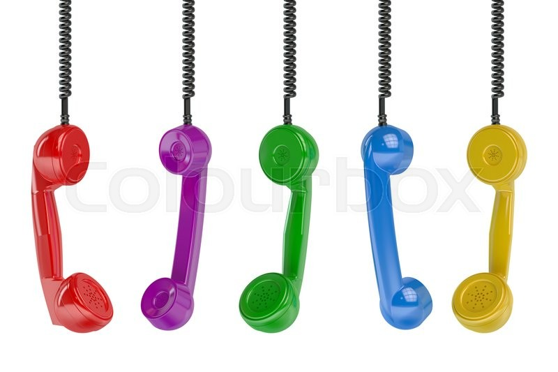 Stock image of 'Multi colored handset in the row isolated on green background'