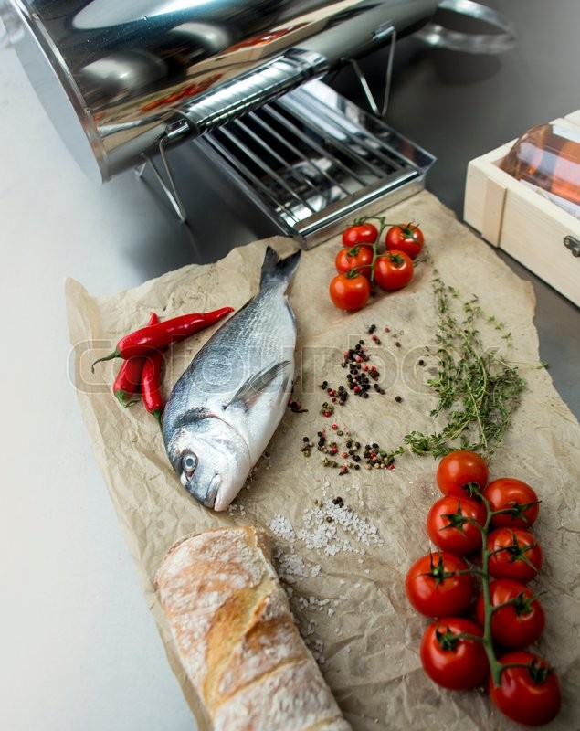 Stock image of 'fresh dorado fish with spices on table, preparation'