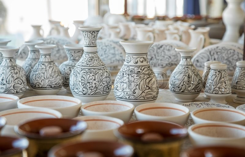 Stock image of 'Bunch of different pattern clay  jars and pots made by greek artists ready to be painted'
