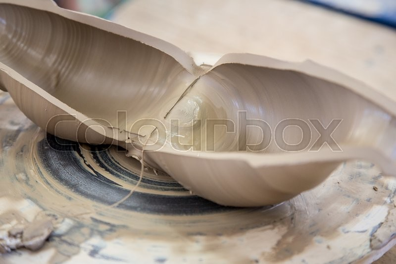 Stock image of 'Fresh made clay jar cut in half '