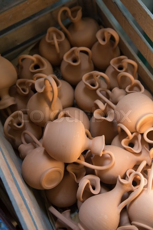 Stock image of 'Box full of small brown clay  jars made by greek artists'
