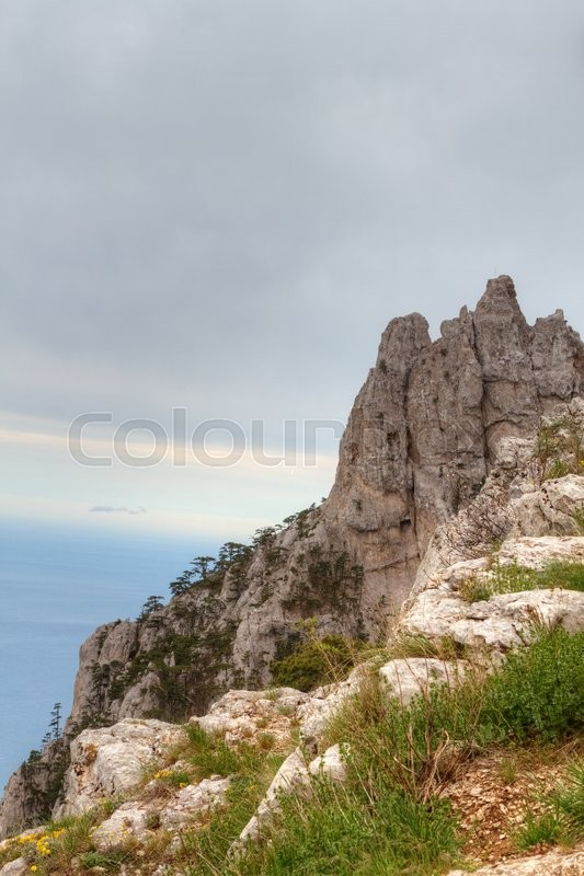 Stock image of 'Rocky Mountain Peak with forest on hillside Ai-petri Crimea Landscape Summer day with blue sky on background'