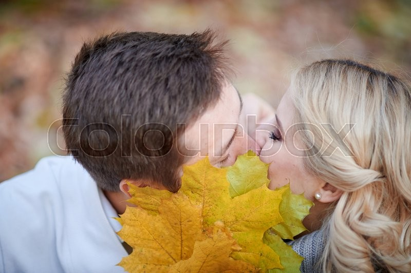 Stock image of 'loving couple kissing in autumn park.'