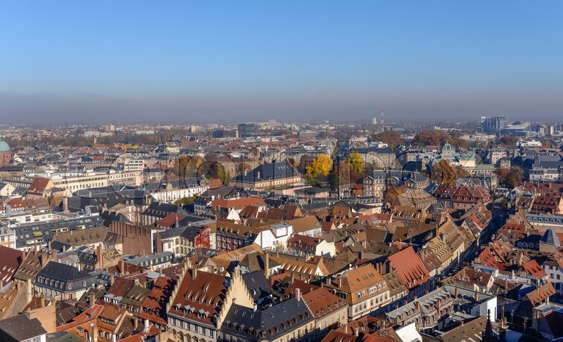 Stock image of 'Various tiled roofs of historical buildings in Strasbourg city center'