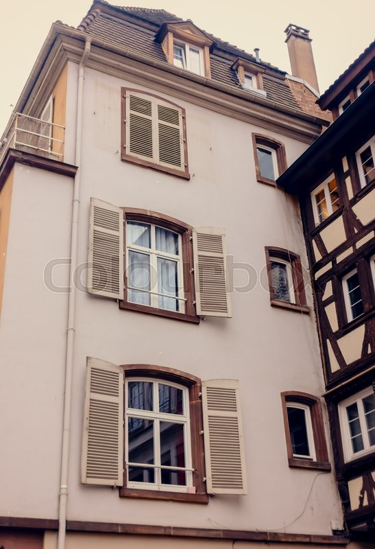 Stock image of 'Facade of an ancient building with large Windows of the European city'