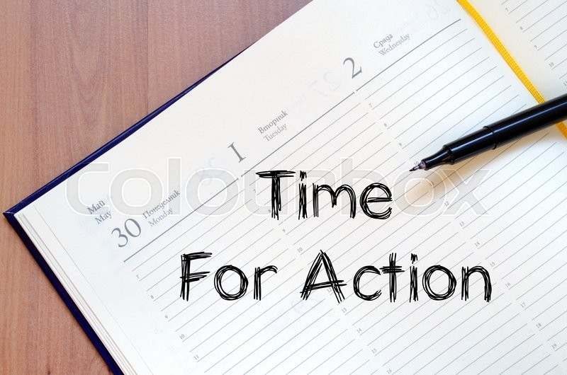 Stock image of 'Time for action text concept write on notebook with pen'