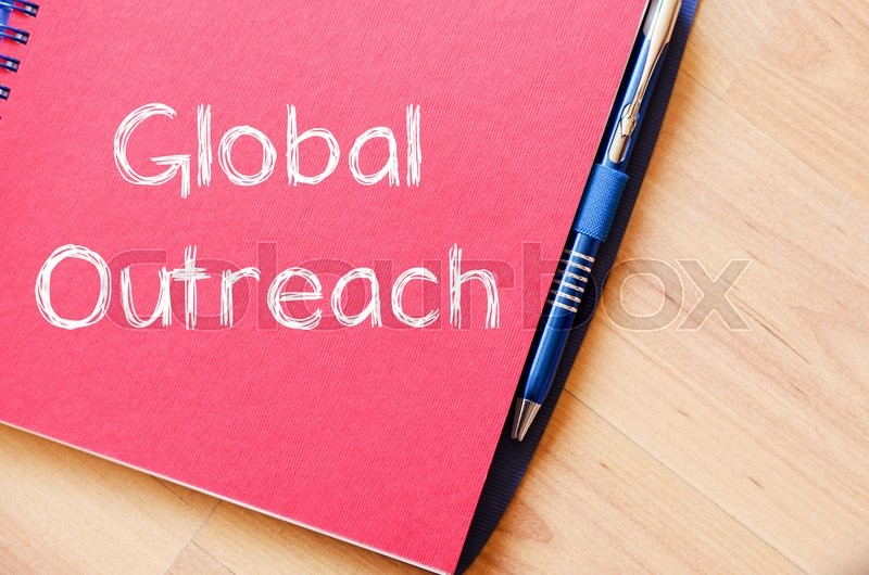Stock image of 'Global outreach text concept write on notebook with pen'