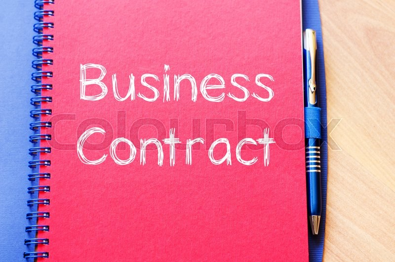 Stock image of 'Business contract text concept write on notebook with pen'