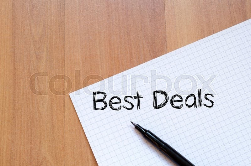 Stock image of 'Best deals text concept write on notebook with pen'
