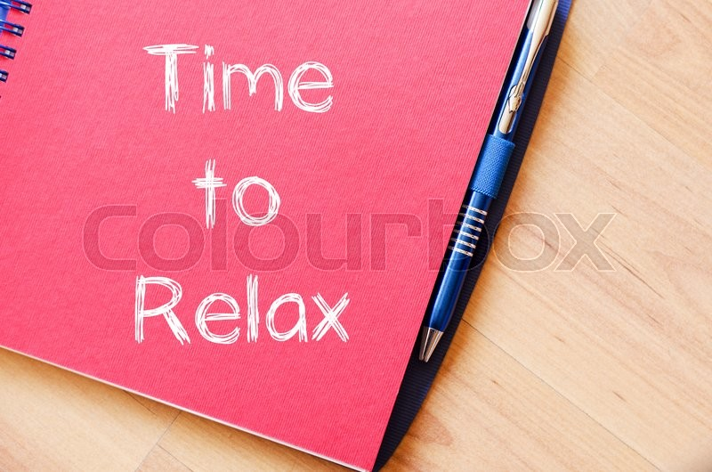 Stock image of 'Time to relax text concept write on notebook with pen'