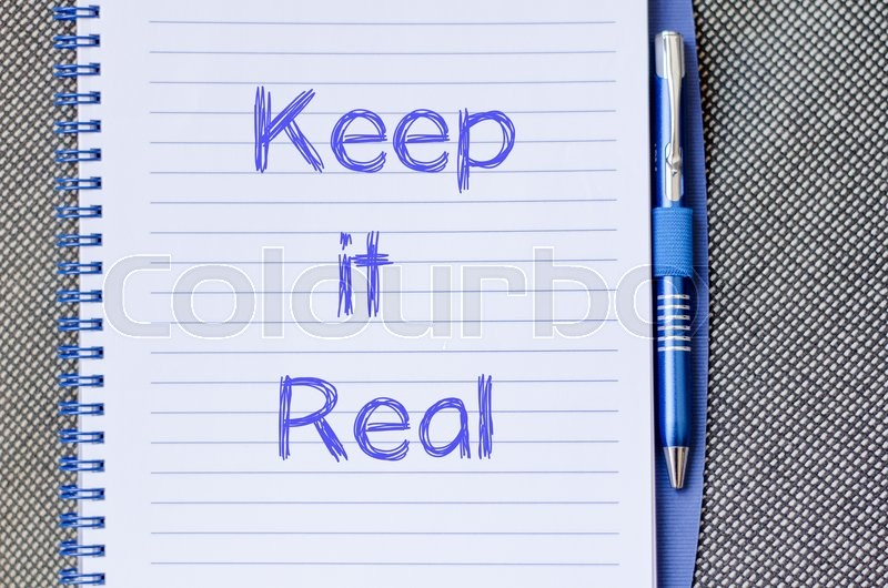 Stock image of 'Keep it real text concept write on notebook with pen'