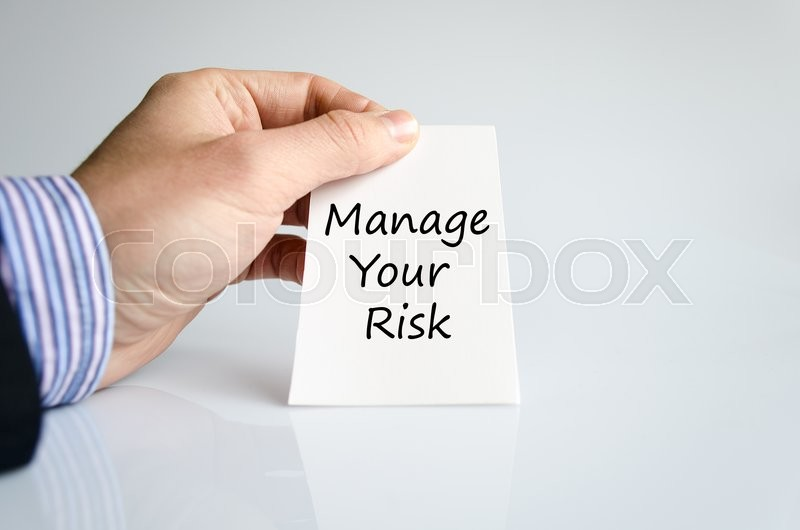 Stock image of 'Manage your risk text concept isolated over white background'