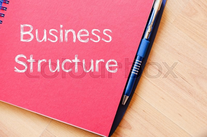 Stock image of 'Business structure text concept write on notebook with pen'