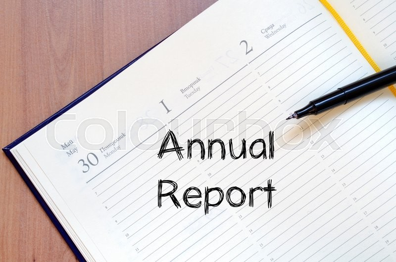 Stock image of 'Annual report text concept write on notebook with pen'