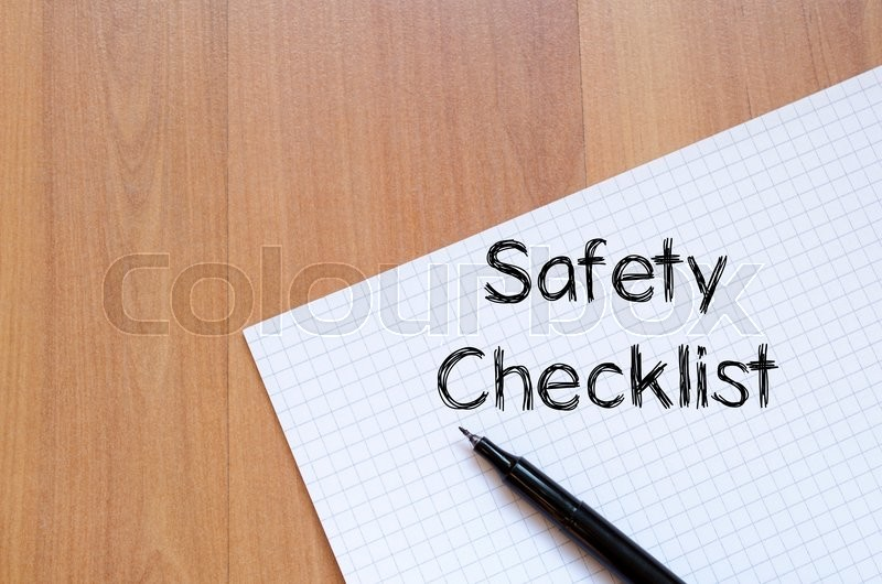 Stock image of 'Safety checklist text concept write on notebook with pen'