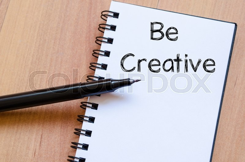 Stock image of 'Be creative text concept write on notebook with pen'