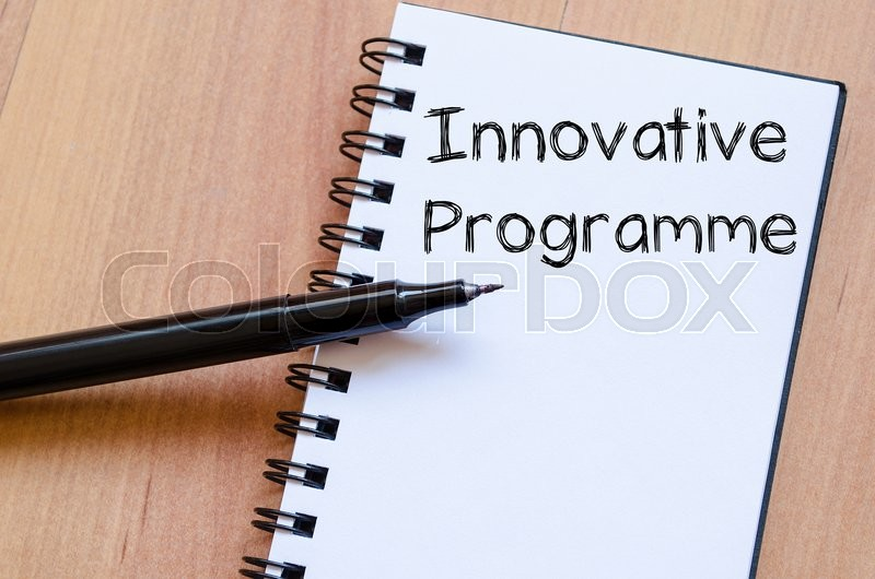 Stock image of 'Innovative programme text concept write on notebook with pen'