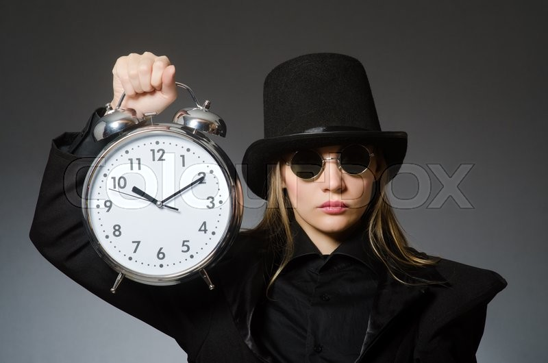 Stock image of 'Woman with clock in business concept'