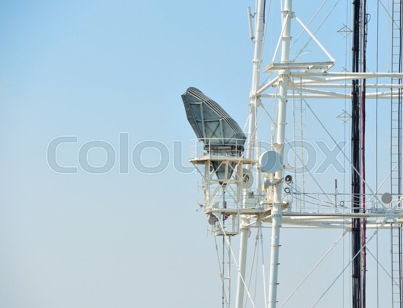 Stock image of 'Mobile phone communication repeater antenna tower in blue sky '