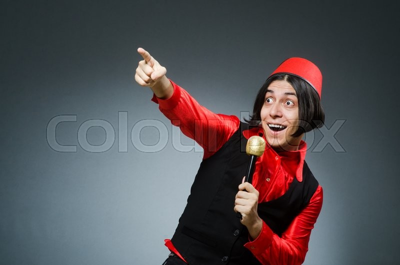 Stock image of 'Man wearing red fez hat'