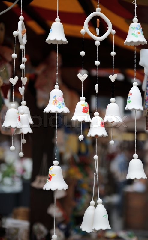 Stock image of 'Souvenir ceramic bells at the market, local national craft of Ukraine'