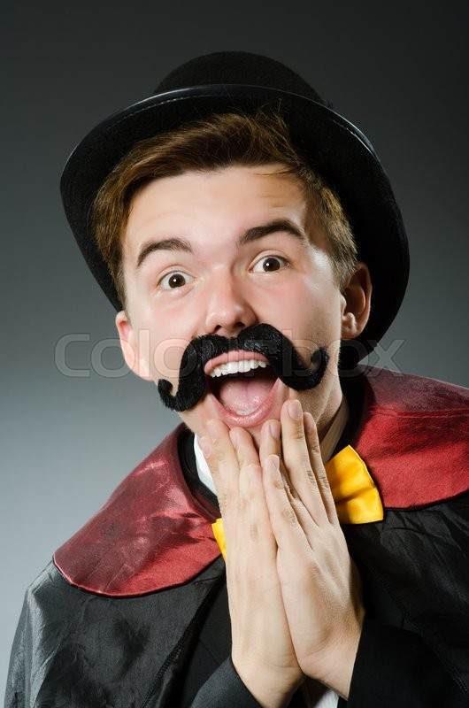 Stock image of 'Funny magician man wearing tophat'