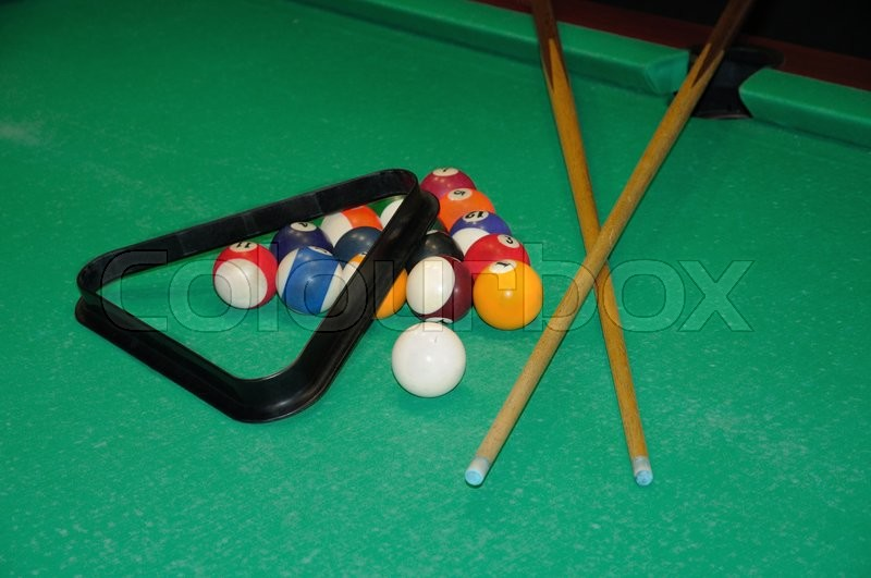 Stock image of 'Billiard balls in a green pool table'