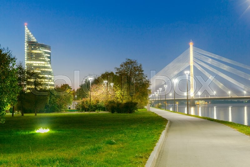 Stock image of 'Modern cable-stayed bridge across the Daugava River in Riga night.'