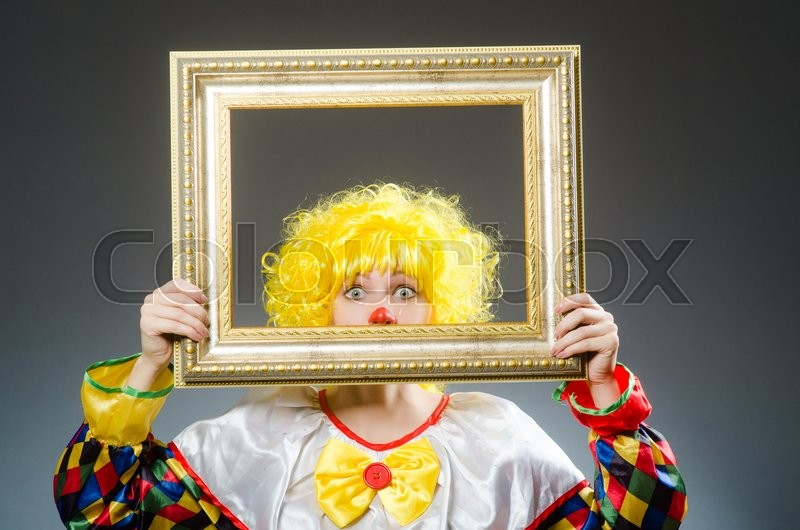 Stock image of 'Clown in funny concept on dark background'