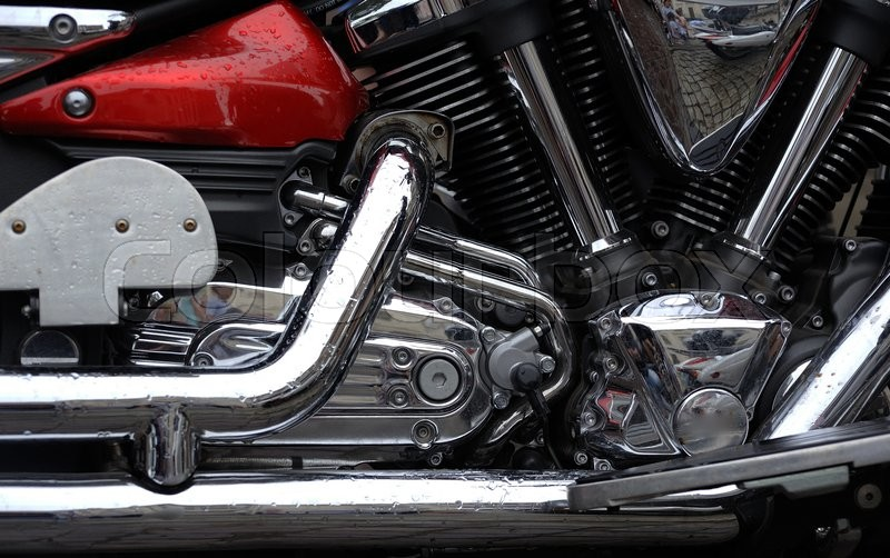 Stock image of 'Closeup of chromed motorcycle engine'