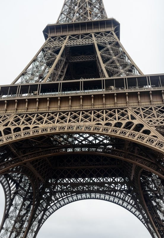 Stock image of 'Low angle view of the Eiffel Tower, Paris, France looking up to the top as it disappears into the mist'