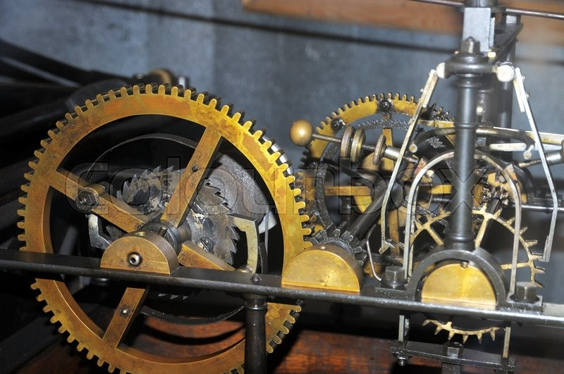Stock image of 'A big old clock mechanism.'