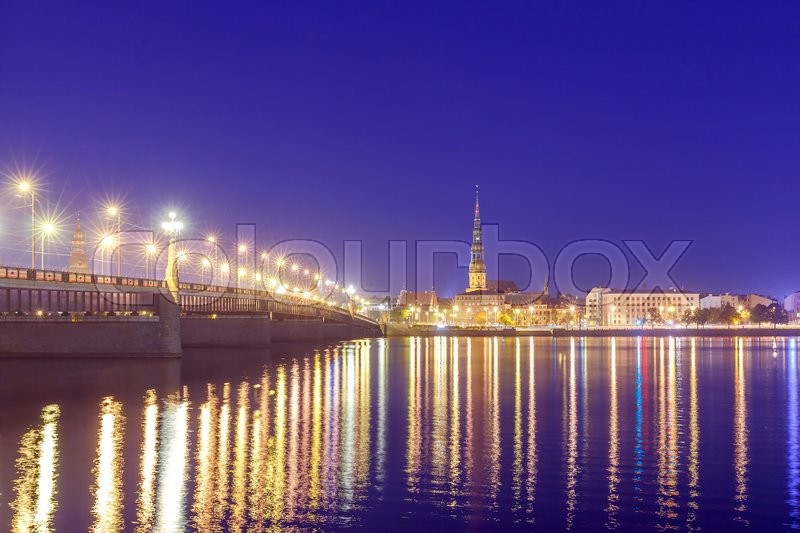 Stock image of 'Evening view on the embankment of the Daugava River and the spiers of churches in Riga.'